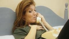 Logorrheic girl rotary phone cu talk Stock Footage