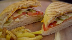 Toast grilled with cheese, vegetables, ham, served with french fries, rotating Stock Footage