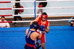 Orenburg, Russia - 28 April 2016: Boys boxers compete Stock Photos