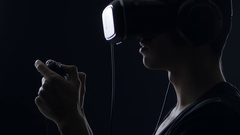 Virtual reality game. Close up of Man with pleasure uses head-mounted display Stock Footage