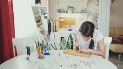 Young woman makes handmade jewelry. Tool for making jewelry Stock Footage