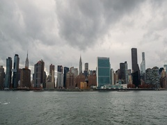 New York City Manhattan buildings skyline cloud moving fast timelapse Stock Footage