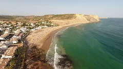 Aerial. Flying above the beach Luz in Lagos Stock Footage