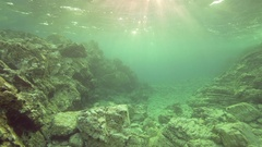 Movement along the underwater volcanic rock illuminated by sunlight Stock Footage