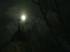 Moon rises over architectural building at night-timelapse Stock Footage