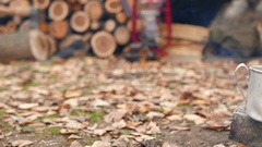 4K.Camp of  tourist. Hot Coffee, bonfire, and autumn leaves. Dolly shot Stock Footage