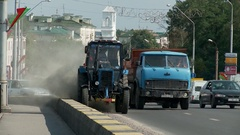 Tractor is sweeping the road starts up a huge cloud of dust and squeak. Stock Footage