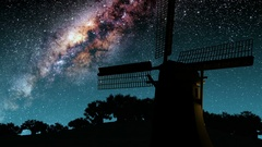 Old windmill and Milky Way stars at night. Elements of this image furnished by N Stock Footage