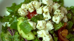 Salad with fresh vegetables, feta cheese and black olives. Rotating shot Stock Footage