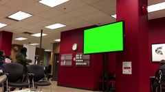 Display tv with green screen on waiting area inside Service Canada Stock Footage