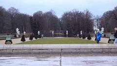 Women walk in Symmetrical lawn gardens, Charlottenburg Palace, Berlin Stock Footage