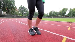 Young woman running at tracks Stock Footage