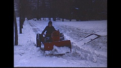Vintage 16mm film, 1951, boy and snowplow clearing snow Stock Footage