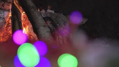 Closeup slow motion of fireplace at Christmas close to lights decoration. Stock Footage