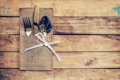 Christmas table place setting and silverware on wood Stock Photos