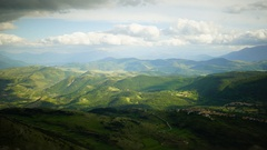 Time lapse of green countryside of mountains, hills in Italy. Vibrant colours. Stock Footage
