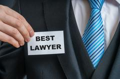 Self-confident man in suit is showing label that He is the best lawyer. Stock Photos