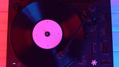 Vinyl disc turning on retro record player, close up Stock Footage