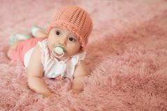 Lying newborn baby with nipple Stock Photos