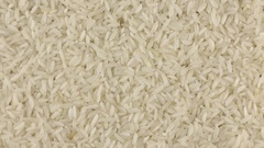 Slow rotation of the heap of rice grains Stock Footage