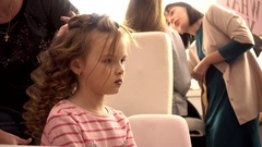 Perfect Fashion make-up hair styling for little child girl model Stock Footage