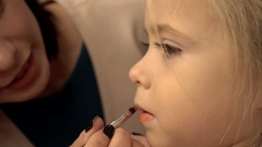 Girl child Make-Up - lipstick for young model blonde Stock Footage