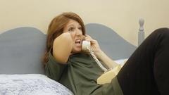 Logorrheic girl rotary phone side talk Stock Footage