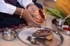 Men Doing Pray Of Lord Ganesha Kuvituskuvat