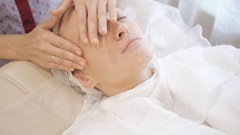 The rejuvenating massage for face in the beauty salon Stock Footage