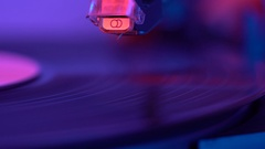 The needle drops on the disc, macro. Vinyl disc turning on retro record player. Stock Footage