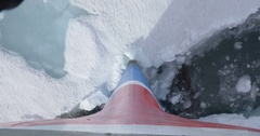 Ship breaks ice in the sea of Spitsbergen Norway Stock Footage