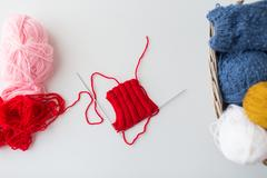 Hand-knitted item with knitting needles Stock Photos