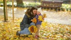 Happy Family, Mother and Child Little Daughter Playing and Holding Leaves Stock Footage