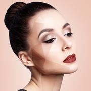 Young woman with geometrical shapes on face Stock Photos