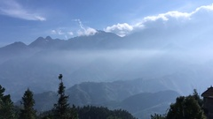 Scenery with mountain peaks and motion clouds mist on sky. Stock Footage