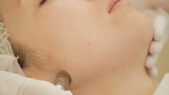 Beautiful woman getting microdermabrasion at beauty clinic Stock Footage