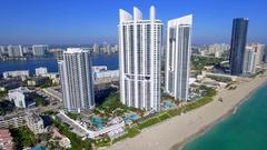 Aerial closeup Trump Towers sunny Isles Beach Florida 4k Stock Footage
