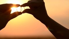 Look at the sun through the gold rings, Stock Footage