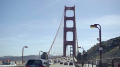 Cars driving across Golden Gate Bridge on clear blue sky day in San Francisco Stock Footage