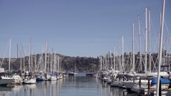 Zooming out from boats docked at Sausalito Yacht Club in San Francisco Stock Footage
