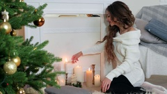 Lighted candles, girl make a wish, blow out a candle, sitting by the fireplace Stock Footage