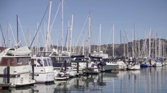 Panning across boats in Sausalito Yacht Club in San Francisco Bay CA Stock Footage
