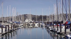 Pulling back from close-up of boats docked at Sausalito Yacht Club in water Stock Footage
