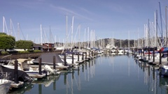 Panning quickly across docked boats in basin at Sausalito Yacht Club 4K Stock Footage