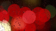 Rain drops on the window with traffic light Stock Footage