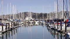 Zooming out from docked boats in water in Sausalito Yacht Club water 4K Stock Footage
