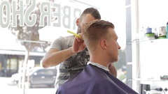 Barber shaves client's hair is razor sharp Stock Footage