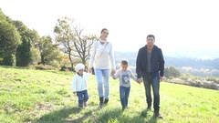 Happy family running in countryside on autumnal week-end Stock Footage