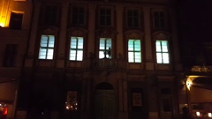 Street art theater over windows of house using projector & shadows of actors Stock Footage