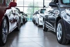 New cars at dealer showroom Stock Photos